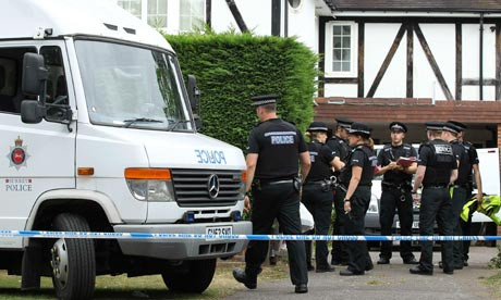 Police at the Hilli family home in Claygate