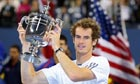 Andy Murray holds the US Open trophy, complete with sponsor's watch and anti-haircut