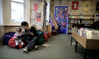 A woman shares a book with her daughter at Ventnor library on the Isle of Wight