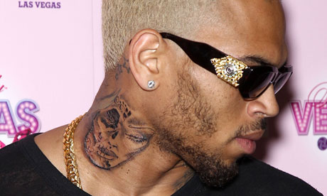 Tattoo on Chris Brown S New Tattoo Looks Like The Face Of A Battered Woman
