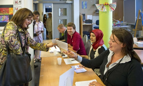 Jolande Sap (L), leader of the green GroenLinks party arrives to cast her vote at a polling station in Amsterdam on September 12, 2012.
