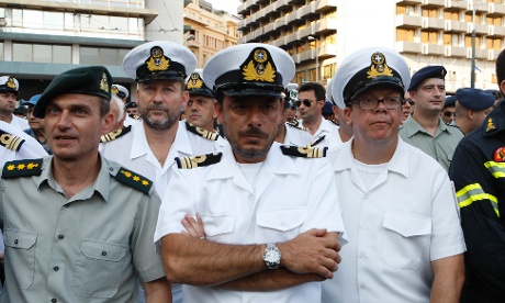 Military officers protest outside the Finance ministry in the center of Athens.
