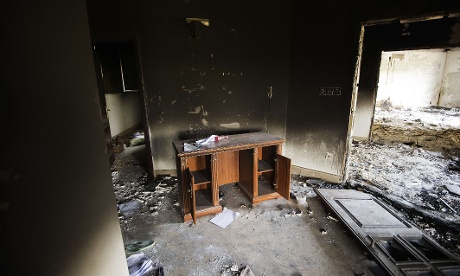 Damage inside the burnt US consulate building in Benghazi.  Libya said it has made arrests and opened a probe into the attack.