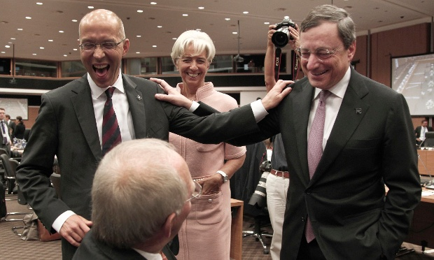 President of the European Central Bank Mario Draghi, right, shares a laugh with  the German Finance Minister Wolfgang Schuble, bottom, the Member of the Executive Board of UCB Jorg Asmussen,  left and the Managing Director of IMF Christine Lagarde prior of the Informal European economic and financial affairs council in capital Nicosia, Cyprus, Friday, Sept. 14, 2012.