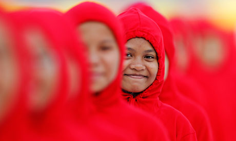 A girl smiles as she waits to perform during Malaysia's National Day celebrations in Kuala Lumpur