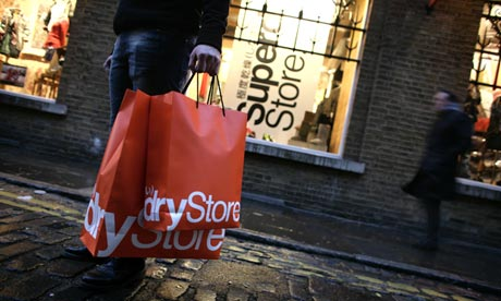 Superdry bags being carried by a shopper