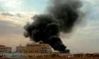 Smoke billows from the US embassy in Khartoum
