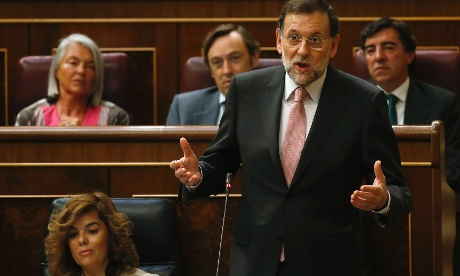 Spanish Prime Minister Mariano Rajoy answers a question during a parliamentary session at the Spanish parliament in Madrid September 12, 2012.
