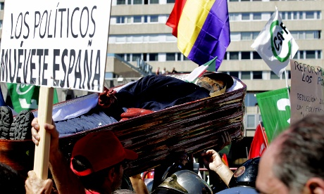 A group of demonstrators hold a mock coffin with an effigy of Spanish prime minister Mariano Rajoy during a protest against Spanish government austerity measures, on 15 September 2012.  Photograph: SERGIO BARRENECHEA/EPA