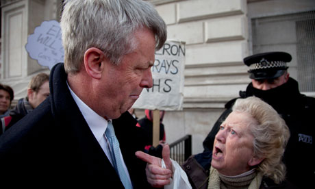 Andrew Lansley is heckled by protester over NHS reform