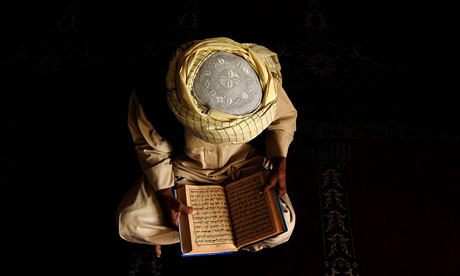 An Afghan Muslim reads the Koran in a mosque in Kabul