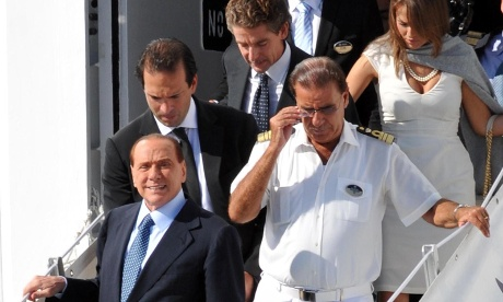 Former Italian premier Silvio Berlusconi (bottom left) disembarks from the MSC Divina for a stopover in Bari, southern Italy 16th September 2012. Berlusconi, who has recently hinted at a return to frontline politics, is on a week long cruise to the Mediterranean.
