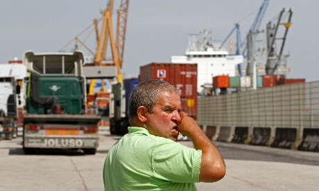A worker gestures at one of the entrances of the Lisbon harbour during a strike by Portuguese harbour workers, in Lisbon September 17, 2012.