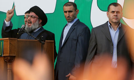 Bodyguards surround Hezbollah leader Hassan Nasrallah as he denounces the anti-Islam film