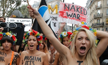 Activists of the women's rights group Femen chant slogans during a march in Paris where they have opened a headquarters in a move to recruit members in their fight against the discrimination of women.