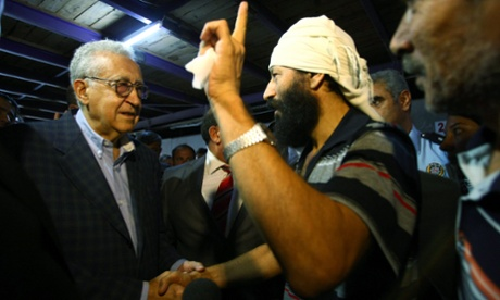 UN Arab League envoy Lakhdar Brahimi  speaks with a Syrian refugee during his visit at Altinozu refugee camp in Hatay, Turkey, 18 September 2012.