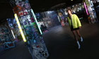 A model showcases designs by Thomas Tait at the Southbank skate park for London fashion week