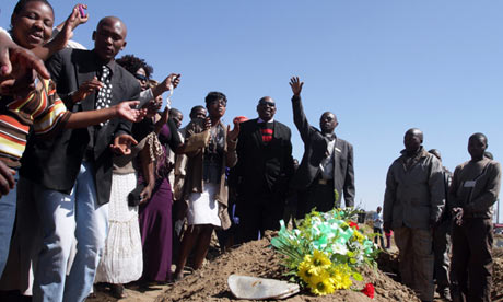 Mourners attend the funeral of one of the 34 people killed by police at Lonmin platinum mine in Marikana in August. Photograph: Tj Lemon/EPA