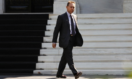 Greek finance minister Yannis Stournaras leaves the meeting with Prime Minister Antonis Samaras and the junior members of the Coalition in Athens today.