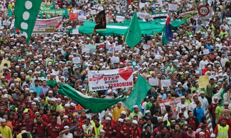Muslim demonstrators in Kuala Lumpur march to the American embassy, protesting against an anti-Islam film made in the US.