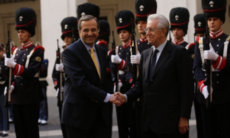 Italian premier Mario Monti, right, shakes hands with Greek Prime Minister Antonis Samaras, at Palazzo Chigi government office, in Rome, Friday, Sept. 21, 2012.
