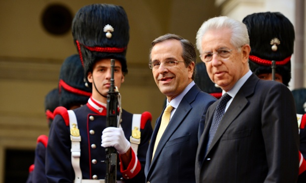 Greece's Prime minister Antonis Samaras (C) stands next to Italian Prime Minister Mario Monti upon arrival at Chigi Palace in Rome on September 21, 2012. Samaras and Monti will attend talks on the economic situation in the Eurozone and the new austerity package.
