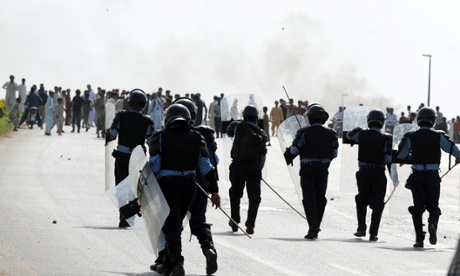 Pakistani riot police chase demonstrators during a protest against an anti-Islam film in Islamabad.  Angry demonstrators set fire to two cinemas in Pakistan's north-western city of Peshawar, police and witnesses said, as the country began a day of protests.