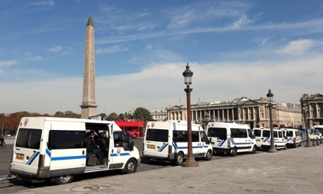 French riot police trucks parked  next to the US embassy in Paris to prevent any protest against the US-made film that mocks Islam.