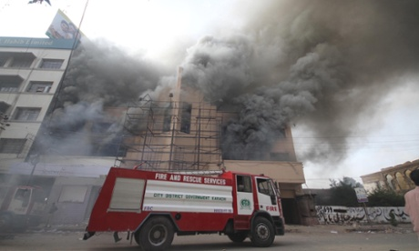 Smoke pours out of a building in Karachi, Pakistan, after a mob started fires  during a protest against an anti-Islam movie entitled Innocence of Muslims made in the US.