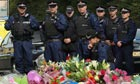 Police look at floral tributes