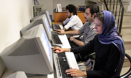 Iranians work at an internet cafe in Tehran