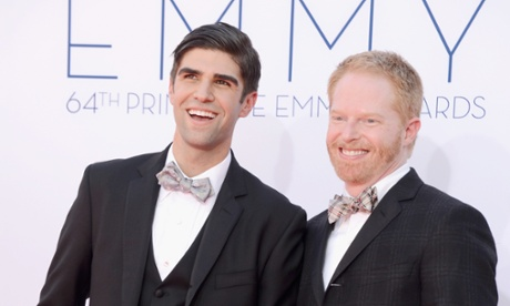 Jesse Tyler Ferguson, right and Justin Mikita arrive the Emmys in LA.