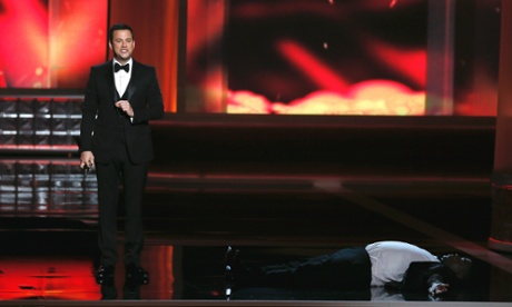 Tracy Morgan lies onstage, pretending to have passed out, in an Emmys sketch