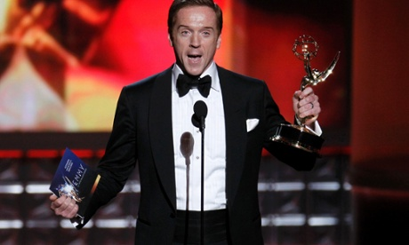 A couple of scenes from the Emmys last night: Damian Lewis accepts the award for outstanding lead actor in a drama series for his role in Homeland at the 64th awards in Los Angeles, September 23.