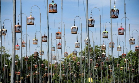 Going for a song: birds sit in their cages during a bird-singing contest in Thailand's southern province of Narathiwat today, 24 September. Hundreds of bird owners from Thailand, Malaysia and Singapore take part in the contest.