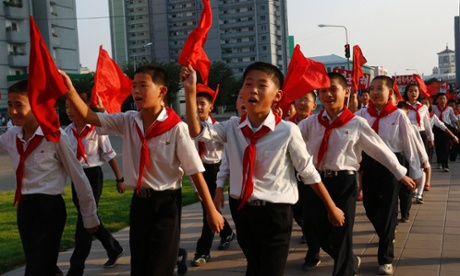North Korean students sing a patriotic song on a street in Pyongyang