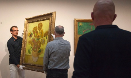 More from the art world: curators remove Vincent van Gogh's famous Sunflowers painting from the wall of the Van Gogh Museum in Amsterdam, the Netherlands. While the museum closes for seven months for renovations, 75 works by the Dutch painter will be displayed at The Hermitage, an Amsterdam satellite of the Russian state museum