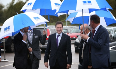 More brolly action as the deputy prime minister, Nick Clegg, arrives at the Ricardo engine assembly plant in Shoreham-by-Sea, Sussex