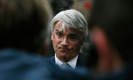 Andrew Mitchell speaks to members of the media as he arrives at the Cabinet Office