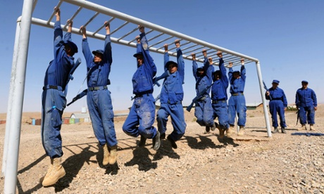 Afghan police cadets run drills during a training exercise at an academy 50 miles from Herat. The cadets have to complete an eight-week course before graduating