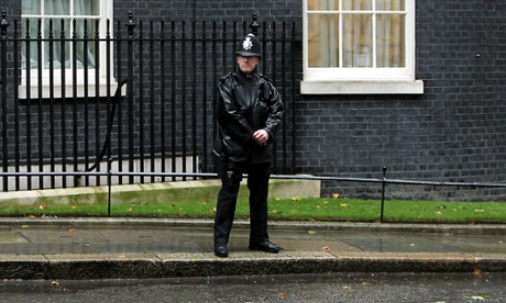 But a policeman's lot is to stand out in the rain