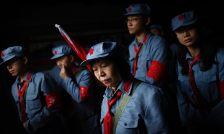 Mid-level government officials dressed in red army uniforms inside an old house where former Chinese leader Mao Zedong used to live. They are on a 5-day training course at the communist party school called China Executive Leadership Academy of Jinggangshan, in Jiangxi province.