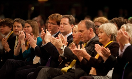 The front row at the Lib Dem conference applauds Vince Cable's speech in Brighton.