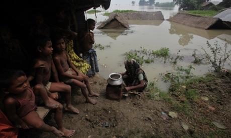 Also in India, a woman prepares a meal for her children near submerged houses in Burhabrhi village about 40 miles east of Gauhati in Assam state. The state government said floodwaters there had killed at least seven people and forced nearly a million to leave their homes
