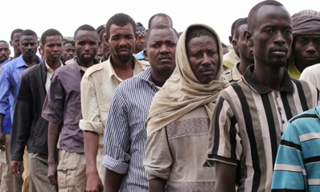 Members of the al-Qaida-linked militant group al Shabab are paraded in Maslah square after their surrender to the authorities in the north of Somalia's capital, Mogadishu. More than 200 members of the militant group surrendered to African Union and Somalia government soldiers on Saturday