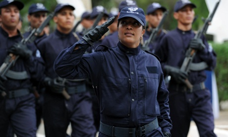 Eyes right! Police cadets parade during their graduation ceremony from the school of the national security in Soumaa in the southern Algerian city of Blida on September 24.