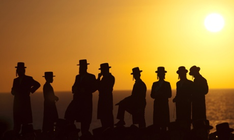 Ultra-Orthodox Jews of the Hassidic sect Vizhnitz gather on a hill overlooking the Mediterranean as they participate in a Tashlich ceremony in Herzeliya, Israel, Monday evening, September 24. Tashlich, which means 'to cast away' in Hebrew, is the practice by which Jews go to a large flowing body of water and symbolically 'throw away' their sins by throwing a piece of bread, or similar food, into the water before the Jewish holiday of Yom Kippur, which starts on Tuesday.