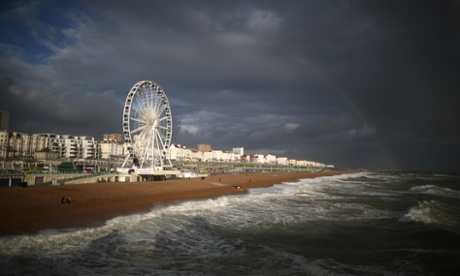 A rainbow appears over Brighton sea-front this afternoon. High winds and some flooding has hit parts of the United Kingdom.