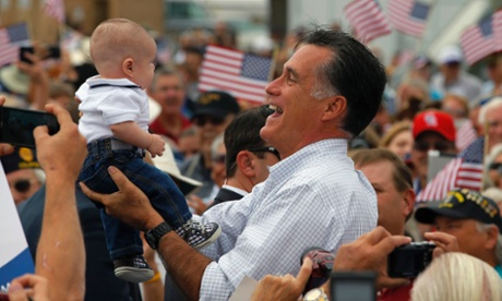 Republican presidential candidate and former Massachusetts Governor Mitt Romney holds up a baby at a campaign rally in Pueblo, Colorado.