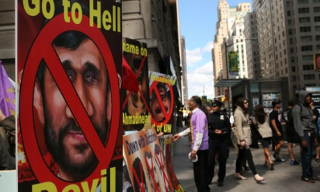 Meanwhile - Demonstrators participate in a rally against the Iranian President Mahmoud Ahmadinejad near the Warwick New York Hotel where the controversial leader is staying for the United Nations General Assembly meeting.  About two dozen demonstrators chanted anti-Ahmadinejad slogans.